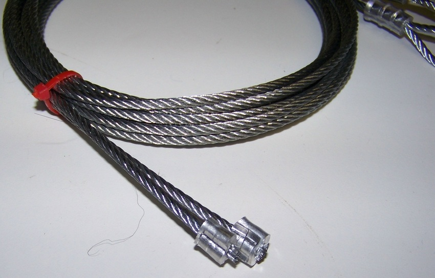 Frayed garage door cable in need of cable replacement