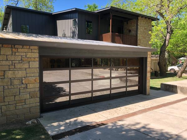 Glass garage doors add curb appeal to any home