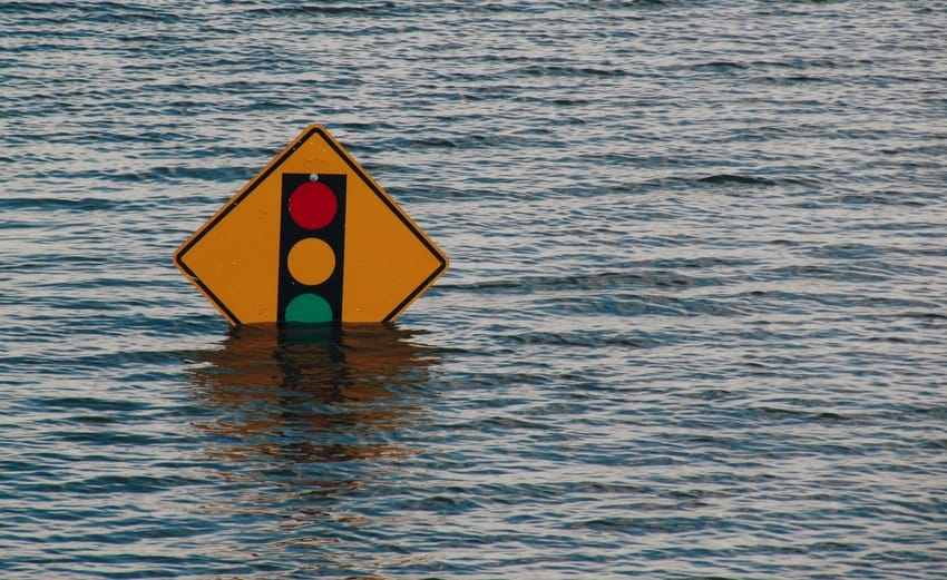Traffic Sign Partially Submerged by Floodwater