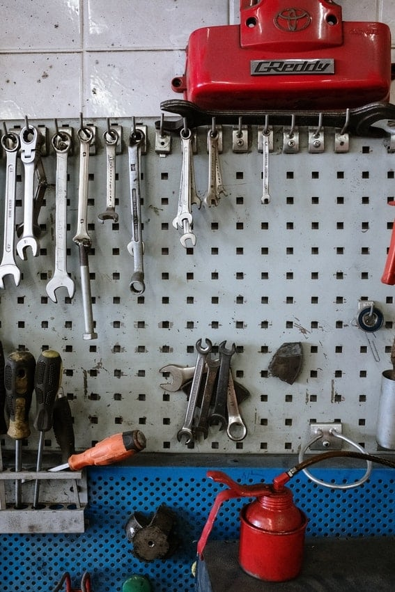 Wrenches, screwdrivers and WD40 in garage workstation