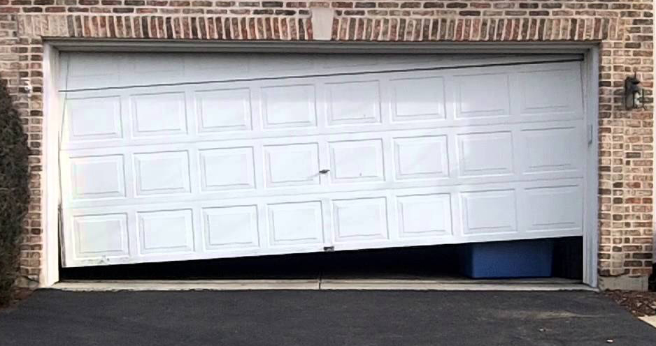 Garage Door Repair and the Causes of Stuck or Crooked Doors
