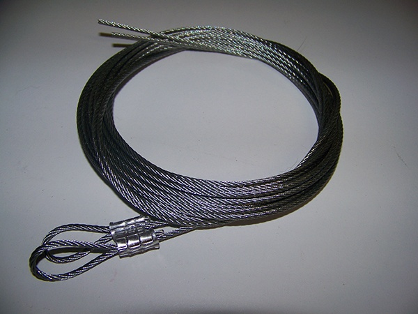 Coiled garage door safety cables prior to installation