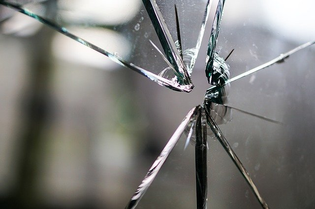 Close Up View of Shattered Glass in Broken Window of Garage Door
