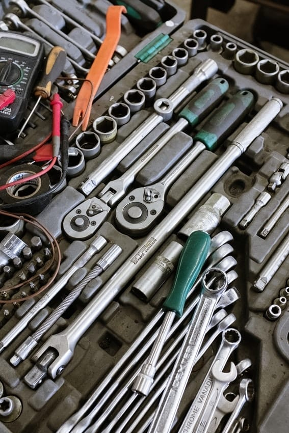 Toolkit with wrenches, nuts, pliers and more for DIY garage repair work